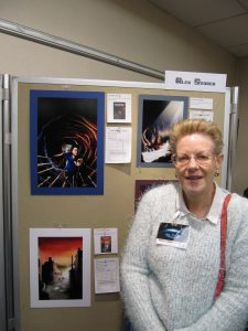 Helen with Floodtide artwork from Alex's art display.